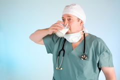 Doctor Drinking Milk Royalty Free Stock Photo