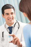 Doctor with drug and patient Royalty Free Stock Images