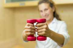 Doctor with dumbbells Royalty Free Stock Photo