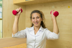 Doctor with dumbbells Stock Photos