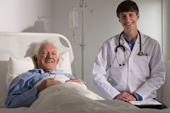 Doctor and elder man smiling Stock Photography