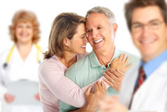 Doctor and elderly couple stock photography