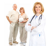 Doctor and elderly couple Stock Photos