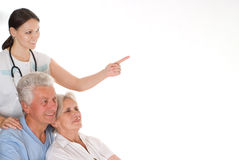 Doctor and  elderly couple Royalty Free Stock Images