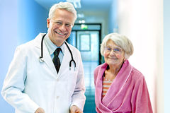 Doctor with Elderly Female Smiling. Royalty Free Stock Photo