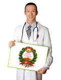 Doctor with empty board. In his hands with Merry Christmas picture Royalty Free Stock Photo