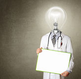 Doctor with empty board and lamp-head. Doctor with empty board in hith hands template and lamp-head, isolated Stock Images