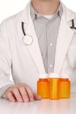 Doctor With Empty Orange Prescription Bottles Royalty Free Stock Photo