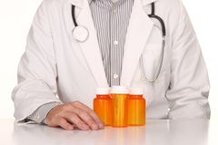 Doctor With Empty Orange Prescription Bottles Royalty Free Stock Photos