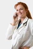 Doctor en una llamada Imagen de archivo