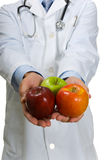 Doctor encouraging Apples Royalty Free Stock Image