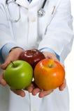 Doctor encouraging Apples Stock Photos
