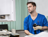Doctor with endoscope. stock photography