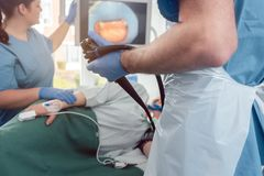 Doctor during endoscopy checking picture of mouth on screen royalty free stock photo