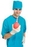 Doctor with an enema syringe Royalty Free Stock Photos
