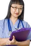 Doctor/enfermera de sexo femenino asiáticos fotografía de archivo