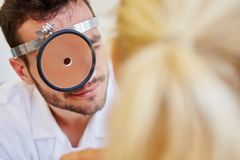 Doctor during ENT examination. For medical diagnose stock images