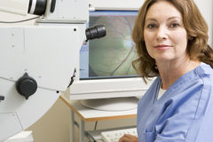 Doctor With Equipment For Detecting Glaucoma Royalty Free Stock Photos