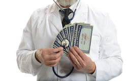 Doctor with esthetoscope and social security cards Stock Image