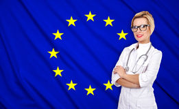 Doctor and european union flag. Female doctor with stethoscope on european union flag background Stock Photography