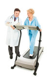 Doctor Evaluates Senior Fitness Stock Photo