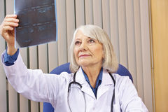 Doctor evaluating x-ray image in office Royalty Free Stock Image