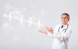 Doctor examinates heartbeat with abstract heart. Proffesional doctor examinates heartbeat with abstract heart royalty free stock photos