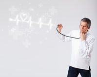 Doctor examinates heartbeat with abstract heart Royalty Free Stock Photography