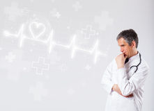 Doctor examinates heartbeat with abstract heart Royalty Free Stock Photo