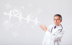 Doctor examinates heartbeat with abstract heart Royalty Free Stock Image