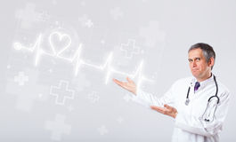 Doctor examinates heartbeat with abstract heart Stock Images