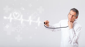 Doctor examinates heartbeat with abstract heart Stock Photography