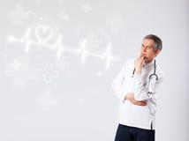 Doctor examinates heartbeat with abstract heart Royalty Free Stock Photos