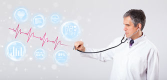 Doctor examinating modern heartbeat graphics Stock Images