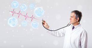 Doctor examinating modern heartbeat graphics Royalty Free Stock Photos