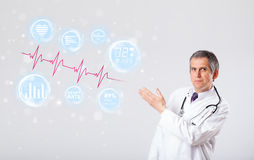 Doctor examinating modern heartbeat graphics Stock Photo