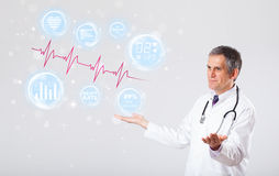Doctor examinating modern heartbeat graphics Stock Photos