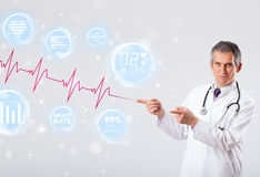 Doctor examinating modern heartbeat graphics Stock Image