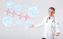 Doctor examinating modern heartbeat graphics Royalty Free Stock Image