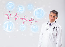 Doctor examinating modern heartbeat graphics Stock Photos