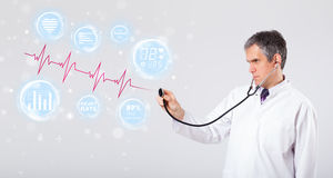 Doctor examinating modern heartbeat graphics Royalty Free Stock Photography