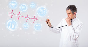 Doctor examinating modern heartbeat graphics Stock Photography
