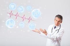 Doctor examinating modern heartbeat graphics Stock Photo