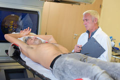 Doctor examinating patient at hospital Royalty Free Stock Photos