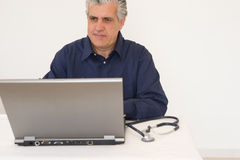 Doctor examination. A doctor examinating a radiography of a patient stock photo