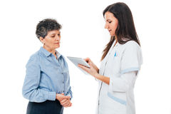 Doctor with examination questionnaire Stock Images