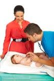 Doctor examine baby breath Royalty Free Stock Photo