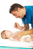 Doctor examine baby neck for sore throat Stock Photos