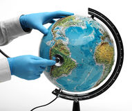 Doctor examine globe. Doctor examine with stetoscope the ill Earth Royalty Free Stock Photo