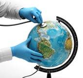Doctor examine globe. Doctor examine with stetoscope the ill Earth Stock Photo